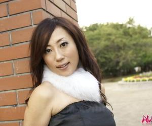 Japanese girl Yuki Motoyama models non nude in a black dress outdoors