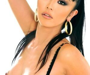 Beautiful Asian model Marica Hase sports hard nipples in a half cut bra