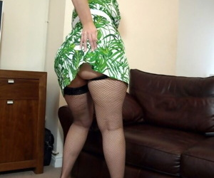 Mature fatty Daniella English spreads chubby legs to display her furry pussy