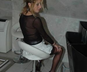 Horny mature Kyras gives hot panty upskirt wearing black stockings and heels