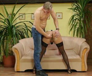 Mature blonde is stripped to stockings before her toy boy fingers her snatch