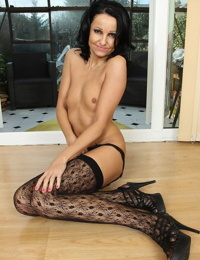 Hot 30 plus brunette Julie D shows her thin body in sexy nylons and garters