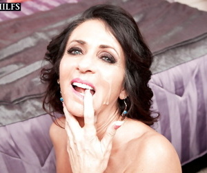Mature brunette Azure Dee taking cum on face after hardcore anal sex