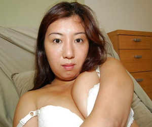 Shy asian chick strips down and has some pussy fingering fun