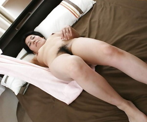 Lusty asian mature lady has some pussy fingering fun after bath