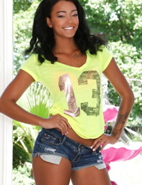 Clothed babe Harley Dean teases her Ebony ass and long legs