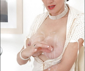 Mature fetish lady playing with her big tits covered with jizz