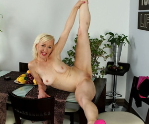 Old MILF Tina takes off her clothes and masturbates on a chair