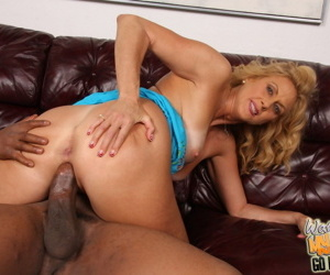 Cuckold wife Dana Devine rides her tanned mature vagina on a black shaft