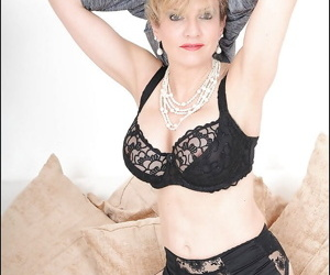 Cute mature Lady Sonia posing in lingerie and jilling vagina
