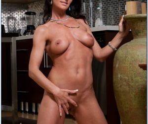 Mature housewife Sarah Bricks cooking something hot in kitchen