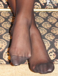 Foot fetish loving girl Valentina wearing black pantyhose