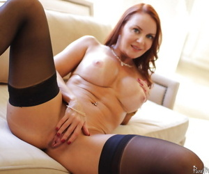 Mature redhead Janet Mason stretches her cute shaved pussy on cam