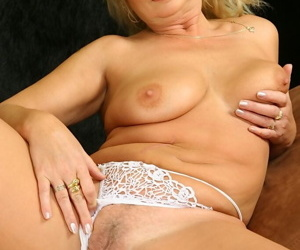 Salacious blonde mature lassie in lingerie revealing her jugs and pussy