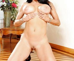 Chesty brunette pornstar Sheila Marie exposing massive boobs