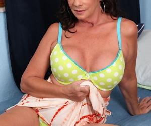 Aged brunette lady Margo Sullivan flashing pretty upskirt panties