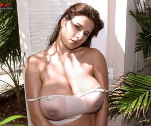 Brunette Euro chick Chloe Vevrier flaunting massive wet tits outdoors