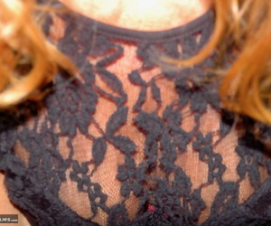 Mature redhead Kyras Nylons hikes her skirt over her pantyhose in the bathroom