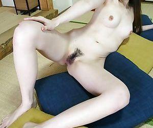 Asian babe Mai Katagiri undressing and exposing her seductive curves
