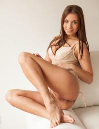Beautiful brunette stunner Sabrisse A preforms an erotic striptease