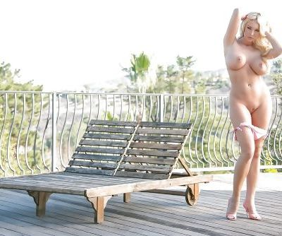 Blonde babe with big tits and shaved pussy Courtney Taylor posing in bikini