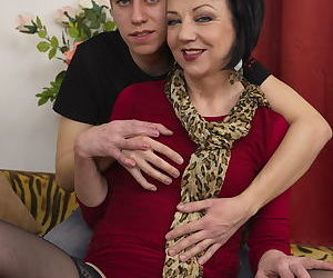 Short haired cougar gives young boy his first sex lessons