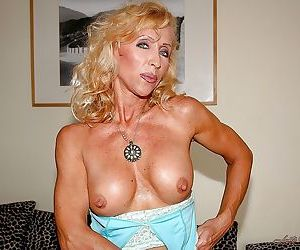 Well toned mature blonde Lenda Murray stripping off her clothes