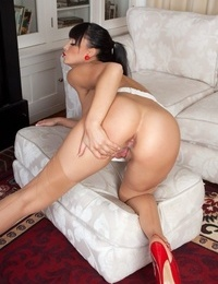 Long legged brunette shows off bald pussy after divesting herself of granny panties