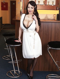 Japanese solo model wraps her huge hooters around bar pile in ebony nylons