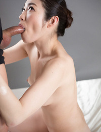 Nude youthful Asian lady kneels to give a blowjob and get a throatful of jizz
