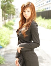 Gorgeous Asian chick Rina Kikukawa poses temptingly entirely clothed outoors