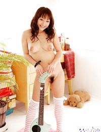 Smiley asian teenage with innate melons sliding off her clothes