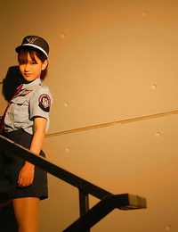 Small asian girl in uniform leisurely uncovering her poundable kinks