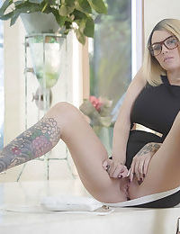 Glasses wearing tattooed blonde Emma Mae exposing large all natural tits