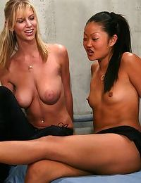 Topless females Brooke Banner and Lucy Lee enjoy foot worship from male sub