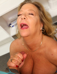 Blonde granny with saggy boobs jerks the jizz from a cock in POV mode