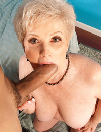 Horny granny Nub gives her youthfull paramour a saggy titjob nd sucks his hard-on