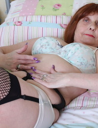 Redhead older granny in black rosebutt poses on her knees flaunting molten ass