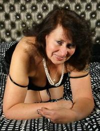 Mature Belgium Plumper hikes her silk lingerie over her captured underwear