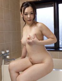 Chubby Japanese woman An Kanoh has help from a man in fondling her melons