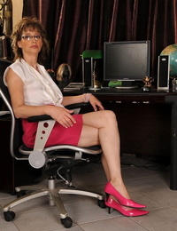 Lusty granny Judyt gets a youthfull stud to her office to fuck her