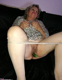 Old chick Caro pleases her nasty vagina with cucumber after nymph\'s hose