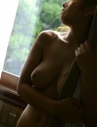 Japanese redhead Yuka Hata reveals huge naturals before gal\'s panties