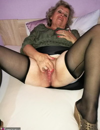 Wild grandmother Caro pleasures her hairy cunt with a lovemaking plaything on her couch