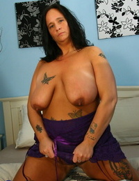 Overweight mature chick with tats sucks on a faux-cock before riding it